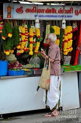 Photograph - Indian Man Stands At Little India Flower Garland Shop Singapore by Imran Ahmed