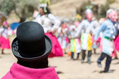 Cholitas Photograph - Indigenous Woman Watching Dancers by Jess Kraft