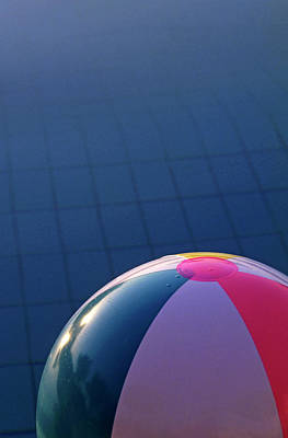 Inflatable Photograph - Inflatable Beach Ball Floating In A Swimming Pool by Sami Sarkis
