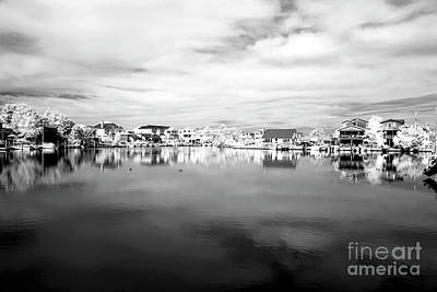 Infrared Beach Houses On The Water Art Print by John Rizzuto