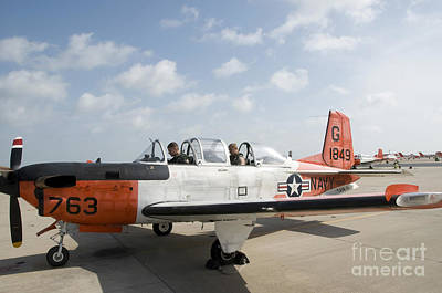 Beechcraft Photograph - Instructor Pilot And Student In A T-34 by Stocktrek Images