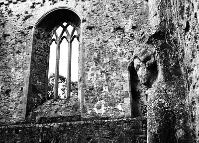 Photograph - Ireland Athassel Priory Tipperary Medieval Ruins Profile Of St Joseph Statue Gothic Window Bw by Shawn O'Brien
