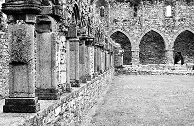 Photograph - Ireland Jerpoint Abbey Cloister Arcade Columns Irish Churches County Kilkenny Black And White by Shawn O'Brien