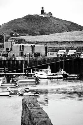 Photograph - Irish Coastal Ballycotton Marina Harbor Boats And Lighthouse County Cork Black And White by Shawn O'Brien