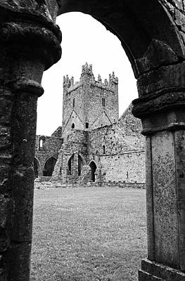 Ireland Photograph - Irish Jerpoint Abbey Tower And Arched Cloister Columns County Kilkenny Ireland Black And White by Shawn O'Brien