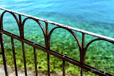Photograph - Iron Fence In Front Of Crystal Clear Water Of Rab, Croatia by Global Light Photography - Nicole Leffer