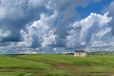 Photograph - Isolated Barren Shed And Dark Rain Clouds by John Williams