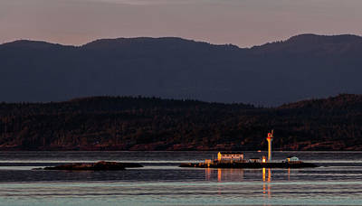 Photograph - Isolated Lighthouse by Ed Clark