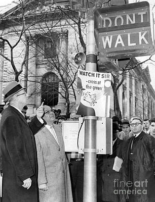 Strau Photograph - Jack Straus Points To Loud Speaker At New York Don't Walk Sign At 42nd St. And Fifth Ave. 1959. by Barney Stein