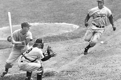 Athletes Rights Managed Images - Jackie robinson stealing home Yogi Berra catcher in 1st game 1955 world series Royalty-Free Image by David Lee Guss