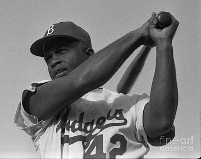 Athletes Royalty-Free and Rights-Managed Images - Jackie Robinson swinging a bat in Dodgers uniform by Celestial Images