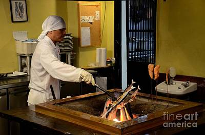 Photograph - Japanese Chef In Kitchen Grills Fish On Indoor Coal Fire Tokyo Japan by Imran Ahmed