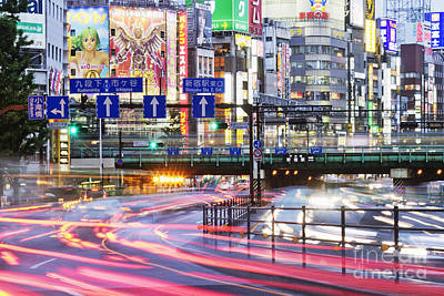 Japanese Downtown Traffic At Dusk Art Print by Jeremy Woodhouse