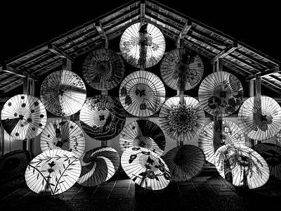 Photograph - Japanese Temple Umbrellas B W by Daniel Hagerman