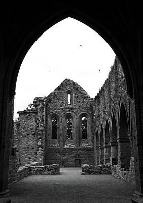 Photograph - Jerpoint Abbey Framed By Arch Medieval 12th Century Ruins County Kilkenny Ireland Black And White by Shawn O'Brien