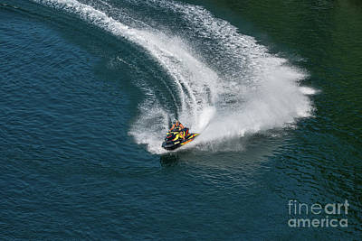 Photograph - Jet Ski On A Dark Blue Water by Les Palenik