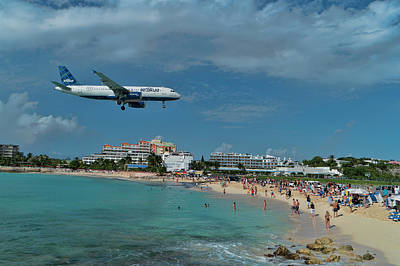 Photograph - jetBlue landing at St. Maarten Airport. by David Gleeson