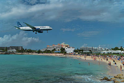 Photograph - jetBlue landing at SXM airport. by David Gleeson