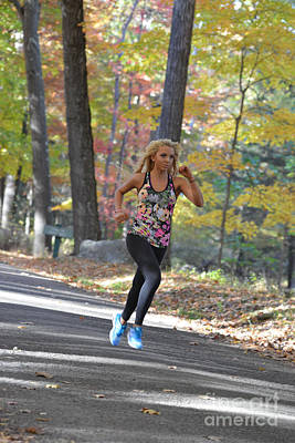 Photograph - Jogging In The Fall Along Country Road by Dan Friend
