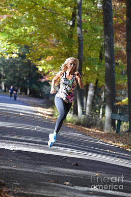 Photograph - Jogging In The Fall Along Road by Dan Friend