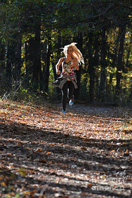 Photograph - Jogging In The Fall On The Fallen Leaves by Dan Friend
