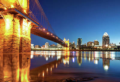 Photograph - John Roebling Bridge Reflections - Cincinnati Skyline by Gregory Ballos