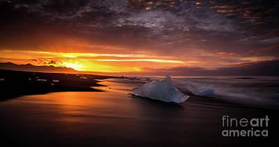 Photograph - Jokulsarlon Sunrays Sunrise Beach Ice by Mike Reid