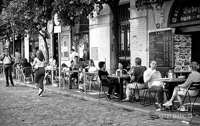 Photograph - Just Another Day In Seville by John Rizzuto