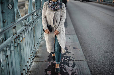 Photograph - A Woman Dressed In Knitted Cardigan Are Walking By The Bridge by Maksym Kaharlytskyi