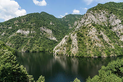 Photograph - Juxtaposition - Rough Limestone Cliffs And A Peaceful Lake In The Mountains by Georgia Mizuleva