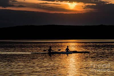 Photograph - Kayaks In The Sunset by Odon Czintos