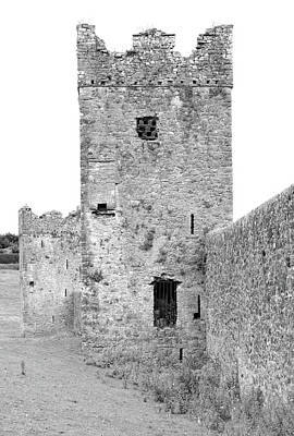 Photograph - Kells Priory Outer Wall Featuring One Of The Seven Towers Castle House Fortification Black And White by Shawn O'Brien