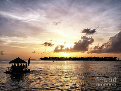 Photograph - Key West Floating Tiki Bar At Sunset by John Rizzuto