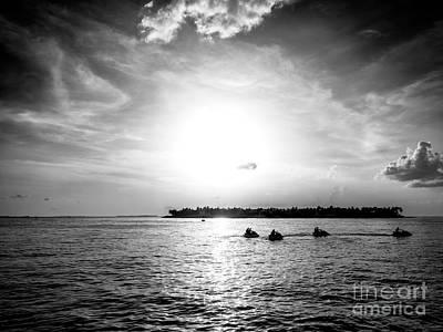 Photograph - Key West Jet Skis At Sunset by John Rizzuto
