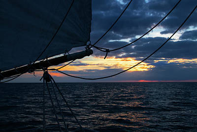 Photograph - Key West Sunset Beyond The Sails by Bob Slitzan