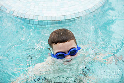Photograph - Kid In A Swimming Pool Surfacing Out Of Water by Michal Bednarek