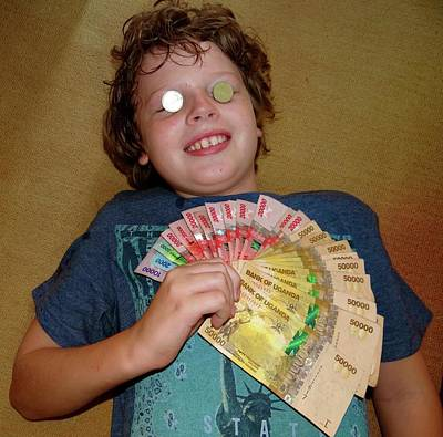 Exploramum Photograph - Kid With Money by Exploramum Exploramum