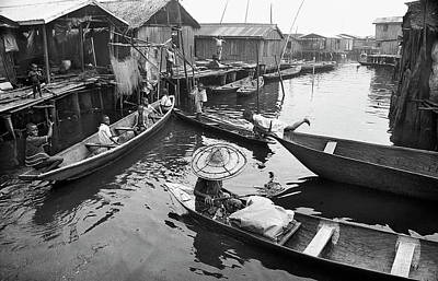 Photograph - Waterways And Canoes by Muyiwa OSIFUYE