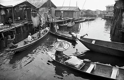 Photograph - Waterways And Canoes by Muyiwa OSIFUYE