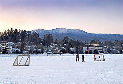 Kids Playing Hockey On Mirror Lake With Lake Placid Village Shown In The Background At Sunset  Art Print
