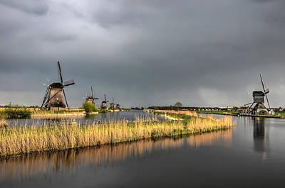 Photograph - Kinderdijk Windmills After The Rain by Frans Blok
