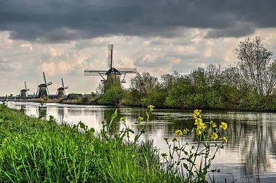 Photograph - Kinderdijk Windmills In Springtime by Frans Blok