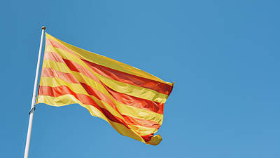 Photograph - La Senyera, The Red And Yellow Flag Of Catalonia Flying In Girona, Spain by Alexandre Rotenberg