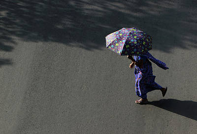 Photograph - Lady In Blue Saree Crossing The Street With An Umbrella by Prakash Ghai