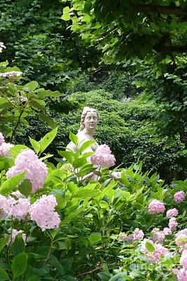 Achieving Royalty Free Images - Lady in Salzburg Garden Royalty-Free Image by Carol Groenen