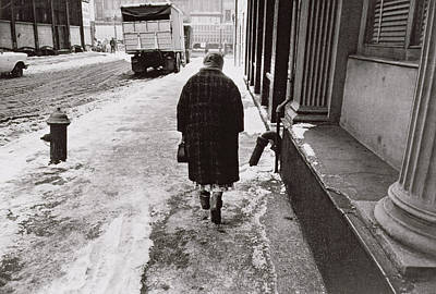 Fire Hydrants Photograph - Lady Walking Towards Canal Street On A Snowy Street by Nat Herz