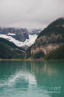Photograph - Lake Louise Canoe by Mike Reid