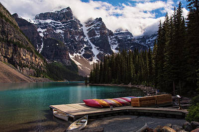 Photograph - Lake Moraine Canoes Canadian Rockies by Dave Dilli