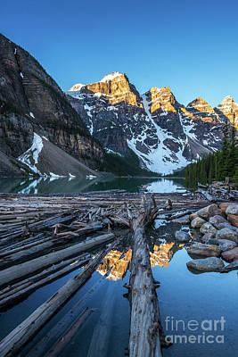 Moraine Lake Photograph - Lake Moraine Peaks Reflection Logscape by Mike Reid