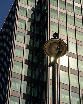 Photograph - Lamp Post Against Green Glass Building by Jacek Wojnarowski